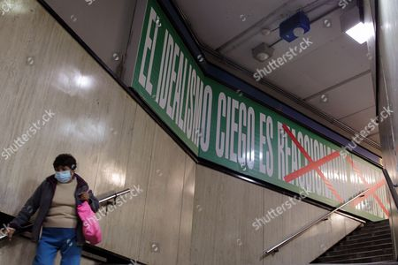 Stock Photo of A Woman Passes by the Exhibition 'Empathy' by Us Artist Barbara Kruger in Mexico City Mexico 24 November 2016 the Exhibition Covers the Walls and Roof of the Bellas Artes Metro Station Mexico Mexico City