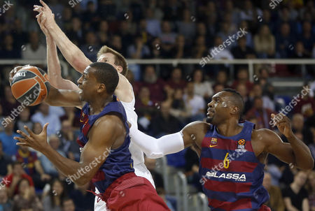 Stock Image of Fc Barcelona's Us Winger Jonathan Holmes (l) and Pivot Joey Dorsey (r) Fight For the Ball with Australian Pivot Brock Motum (c) of Zalgiris Kaunas During Their Euroleague Game Played at Palau Blaugrana Stadium in Barcelona Catalonia Spain on 10 November 2016 Spain Madrid