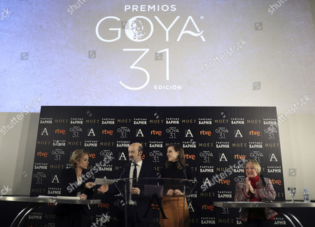 Notary Eva Sanz (l) Hands in the Envelope with Nominees to the 31st Edition of the Film Goya Awards to Spanish Actor Javier Camara (2l) and Actress Natalia De Molina (2r) Before President of the Spanish Academy of Arts and Cinematographic Sciences Yvonne Blake (r) During a Ceremony Held at the Academy's Headquarters in Madrid Spain 14 December 2016 the Favourite Films For the Goya Awards Are 'A Monster Calls' with 12 Nominations of Spanish Director Juan Antonio Bayona; 'The Man with Thousand Faces' of Director Alberto Rodriguez and 'The Fury of a Patient Man' of Raul Arevalo Both of Them with 11 Nominations Spain Madrid