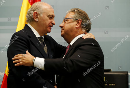 New Spanish Home Minister Juan Ignacio Zoido (r) Huges His Predecessor Jorge Fernandez Diaz (l) As Zoido Takes Office at Spanish Home Ministry in Madrid Spain 04 November 2016 Spanish Prime Minister Mariano Rajoy (unseen) Announced the Day Before the Names of His New Ministers For Next Term of Office Spain Madrid