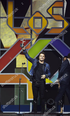 Spanish Singer Dani Martin Holds Up the Best Videoclip Award on Stage During the 50th Anniversary Gala of the Radio Channel 40 Principales Held at Sant Jordi Palace of Barcelona Spain 01 December 2016 Spain Barcelona