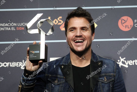 Spanish Singer Dani Martin Poses with the Best Videoclip Award During the 50th Anniversary Gala of the Radio Channel 40 Principales Held at Sant Jordi Palace of Barcelona Spain 01 December 2016 Spain Barcelona