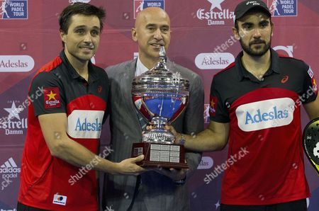 Paddle Tennis Players Fernando BelasteguÝn (l) and Pablo Lima (r) Receive the Trophy by World Padel Tour's Director Mario Hernando (c) After Defeating Maxi Sanchez and Matias Diaz (not Seen) in the Men's Final of the Zaragoza Paddle Tennis Open 2016 a Tournament Which Counts Towards the World Padel Tour 2016 at Prince Felipe Sports Pavilion in Zaragoza City Spain 30 October 2016 Spain Zaragoza