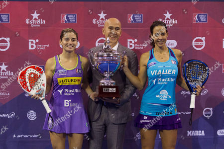 Paddle Tennis Players Marta Marrero (r) and Alejandra Salazar (l) Poses with World Padel Tour's Director Manager Mario Hernando (c) and the Winner Trophy After Their Victory Against Twins Sanchez-alayeto During the Women's Final of the Zaragoza Paddle Tennis Open 2016 a Tournament Which Counts Towards the World Padel Tour 2016 at Prince Felipe Sports Pavilion in Zaragoza City Spain 30 October 2016 Spain Zaragoza