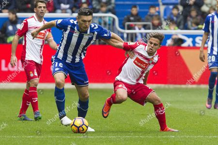 Rcd Espanyol's Player Melendo (r) Struggles For the Ball Against Diego Torres of Deportivo Alaves During Their Spanish Primera Division League Soccer Match at the Stadium of Mendizorroza in Vitoria Spain 20 November 2016 Spain Vitoria