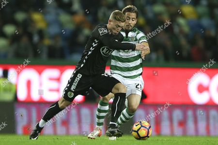 Sporting Lisbon's Joao Pereira (r) Fights For the Ball with Nuno Santos of Vitoria De Setubal During Their Portuguese First League Soccer Match Held at Alvalade Stadium Lisbon Portugal 03 December 2016 Portugal Lisbon