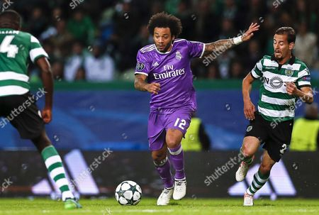 Sporting's Joao Pereira (r) in Action Against Real Madrid's Marcelo (c) During the Uefa Champions League Group F Soccer Match Between Sporting Lisbon and Real Madrid at Alvalade Stadium in Lisbon Portugal 22 November 2016 Portugal Lisbon