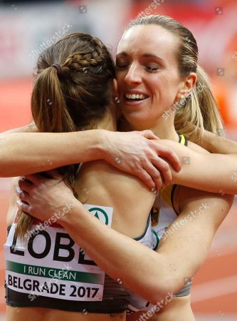 Germany's Cindy Roleder celebrates with her teammate Ricarda Lobe after winning the gold medal during the European Athletics Indoor Championships in Belgrade, Serbia