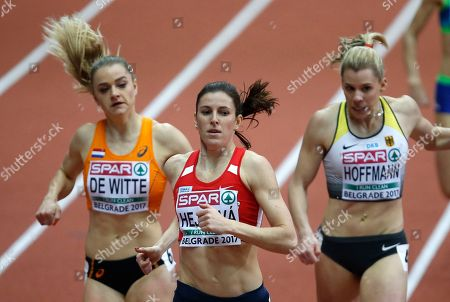 Netherlands' Lisanne De Witte, Czech Republic's Zuzana Hejnova and Germany's Lara Hoffmann, from left, compete in a women's 400-meter qualifying heat during the European Athletics Indoor Championships in Belgrade, Serbia
