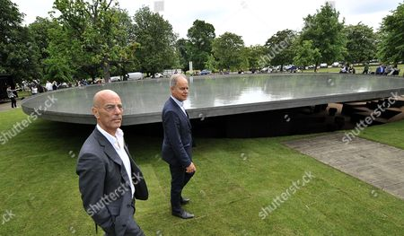Swiss Architects Jacques Herzog (l) and Pierre De Meuron (r) at the 2012 Serpentine Gallery Pavilion in London Britain 31 May 2012 the Serpentine Gallery Pavilion Designed by Herzog and De Meuron and Chinese Artist Ai Weiwei is the Twelfth Commission in the Gallery Annual Series the 2012 Pavilion Takes Visitors Beneath a Roof of Water Below the Serpentine's Lawn to Explore the Hidden History of Its Previous Pavilions Ai Weiwei was not Present Because He is Forbidden to Leave China United Kingdom London
