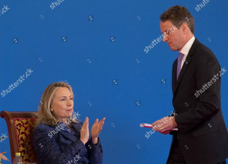 Us Secretary of State Hillary Clinton (l) Applauds After the Speech Delivered by Us Treasury Secretary Tim Geithner at the Opening Ceremony of the Fourth Round of the Us-china Strategic and Economic Dialog at the Diaoyutai State Guesthouse in Beijing China 03 May 2012 the Talks Are Headed by Senior Members of Government From Both Sides and Will Wrangle with a Number of Economic and Trade Issues That Are Having Global Repercussions China Hong Kong
