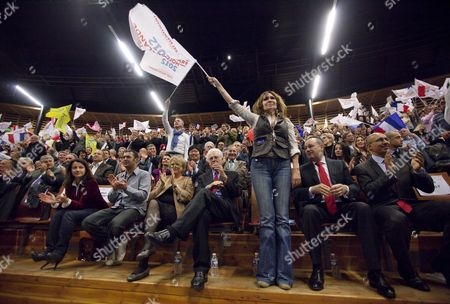 Stock Photo of French Actress Clementine Celarie (c) Waves a Flag Flanked by Europe-ecology Green Party Secretary Cecile Duflot (l) and Former Presidential Green Party Eva Joly (3-l) and Former French Socialist Party Leader Lionel Jospin (4-l) As They Attend French Socialist Party (ps) Candidate For the 2012 French Presidential Election Francois Hollande's Campaign Rally in Limoges Central France 27 April 2012 France Limoges