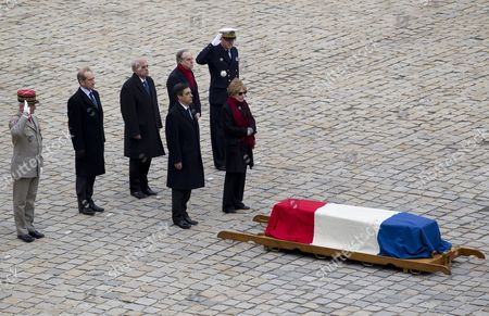 French Defense Minister Gerard Longuet (2-l) French Culture Minister Frederic Mitterand (2-r) Prime Minister Francois Fillon (front L) and Patricia Schoendoerffer (front R) Stand to Attention in Front of the Coffin of Late French Award-winning Filmmaker and War Correspondent Pierre Schoendoerffer During a Funeral Ceremony at the Invalides in Paris France 19 March 2012 Schoendoerffer Died 14 March 2012 Aged 83 France Paris