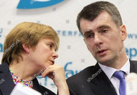 Russian Businessman Mikhail Prokhorov (r) Talks to His Sister and Political Supporter Irina (l) During a News Conference to Announce the Creation of an Non-typical Party in Moscow Russia 04 June 2012 His New Project is a 'Civil Platform' Party Intended to Be a Party of Wide Range of Civil Society the Party Will Have Only 500 Members - Professional Lawyers Giving Support For the Most Clever Civil Activists Prokhorov was Reported not to Reject For Himself the Idea to Take Part in Moscow's Mayoral Elections Russian Federation Moscow