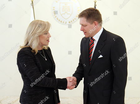 Stock Photo of Outgoing Slovak Prime Minister Iveta Radicova (l) Welcomes Her Successor the Leader of the Smer Social Democracy Party Robert Fico (r) at the Slovak Government Office in Bratislava Slovakia 04 April 2012 Slovakia (slovak Republic) Bratislava