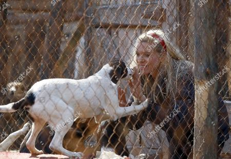 Princess Maja Von Hohenzollern (r) Ambassador and Spokeswoman For the European Animal and Nature Protection Group (etn) Plays with Dog During Her Visit in the 'Sirius' Animal Protection Shelter in Tolokun Village Ukraine 11 April 2012 Maja Von Hohenzollern Arrived in Ukraine to Deliver Two Field Kitchens to a Local Animal Protection Shelter and to Draw Attention to an Allegedly Ongoing Government Programme to Destroy Stray Dogs in Connection with the Euro 2012 Football Championship Ukraine Kiev