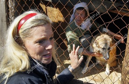 Princess Maja Von Hohenzollern (r) Ambassador and Spokeswoman For the European Animal and Nature Protection Group (etn) Reacts During Her Visit to the 'Sirius' Animal Protection Shelter in Tolokun Village Some 80 Km From Kiev Ukraine 11 April 2012 Maja Von Hohenzollern Arrived in Ukraine to Deliver Two Field Kitchens to a Local Animal Protection Shelter and to Draw Attention to an Allegedly Ongoing Government Programme to Destroy Stray Dogs in Connection with the Euro 2012 Football Championship Ukraine Kiev