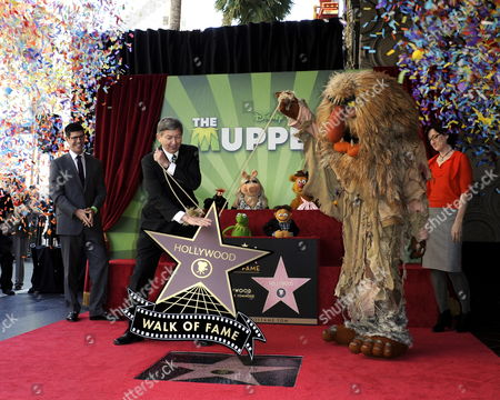 Confetti Cannons Fire As Walt Disney Studios President Rich Ross (l) and the Jim Henson Company Ceo Lisa Henson (r) Watch Hollywood Chamber of Commerce President/ceo Leron Gubler (2-l) and Sweetums (2-r) Unveil the Muppets' Star on the Hollywood Walk of Fame During Ceremony in Hollywood California Usa 20 March 2012 the Muppets Were Awarded the 2 466th Star on the Hollywood Walk of Fame in the Category of Motion Pictures United States Hollywood