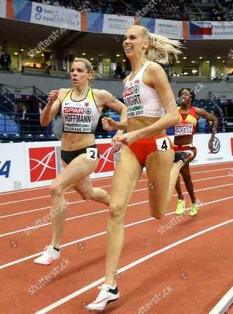 Germany's Lara Hoffmann (L), Poland's Iga Baumgart (C) and Spain's Lorena Bokesa (R) compete in the Women's 400m Semifinals, heat 2,  at the European Athletics Indoor Championships in Belgrade, Serbia, 03 March 2017.