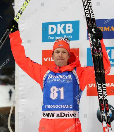 Second placed Lowell Bailey of the U.S. celebrates during the flower ceremony for the men's 10 km sprint competition at the Alpensia Biathlon Centre in Pyeongchang, South Korea