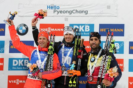 Winner Julian Eberhard of Austria, center, second placed Lowell Bailey of the U.S., left, and third placed Martin Fourcade of France, right, pose for the media during the flower ceremony for the men's 10 km sprint competition at the Alpensia Biathlon Centre in Pyeongchang, South Korea