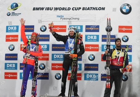 Winner Julian Eberhard of Austria, center, second placed Lowell Bailey of the U.S., left, and third placed Martin Fourcade of France, right, celebrate during the flower ceremony for the men's 10 km sprint competition at the Alpensia Biathlon Centre in Pyeongchang, South Korea