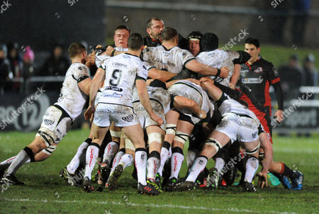 Edinburgh front row of (L to R) Murray McCallum, Neil Cochrane and Alasdair Dickinson give the Ospreys pack a difficult time at this scrum.