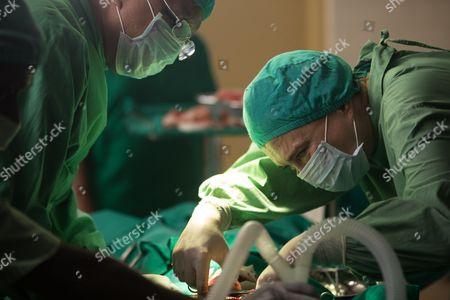 Darshan Jariwalla as Dr Ram Nair and Amanda Redman as Dr Lydia Fonseca
