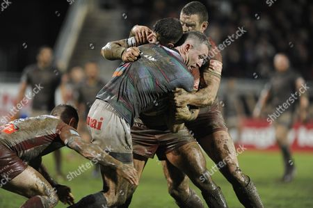 Chris Houston of Widnes tackled by Ben Garcia and Luke Burgess during the Rugby league, BETFRED SUPER LEAGUE game, round 3, Gilbert Brutus stadium Perpignan France, saturday march 4 th 2017, Dragons Catalans (Perpignan) vs Widnes Vikings - Credit photo : Pascal RODRIGUEZ/SIPA