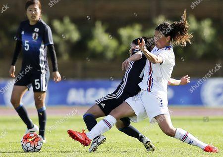 Japanese player Emi Nakajima (L) fights for the ball with icelandic Sara Bjork Gunnarsdottir during the match of the Women Soccer Algarve Cup held at Estadio da Bela Vista, Lagoa, Portugal, 03 March 2017.