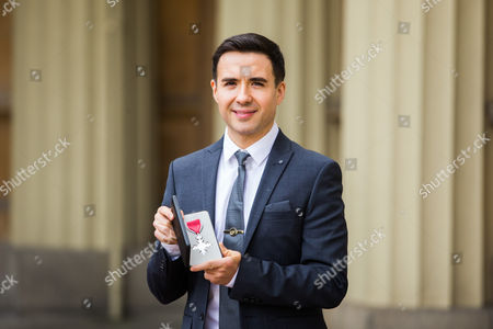 Table tennis player William Bayley poses for a photograph after receiving their MBE's at Buckingham Palace