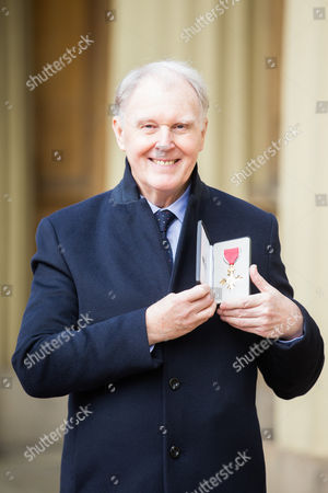Stock Image of Tim Pigott-Smith poses for a photograph after receiving his OBE at Buckingham Palace