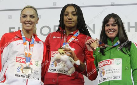 Gold medal winner Thiam Nafissatou of Belgium (C), silver medal winner Ivona Dadic of Austria (L) and bronze medal winner Gyorgyi Zsivoczky-Farkas of Hungary (R) celebrate during the Women's pentathlon medal ceremony at the European Athletics Indoor Championships in Belgrade, Serbia, 03 March 2017.