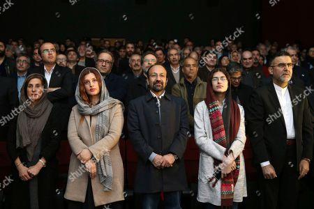 "Asghar Farhadi, Parisa Bakhtavar, Sarina Farhadi, Fatemeh Motamed Arya, Hojjatollah Ayoubi Iranian director Asghar Farhadi, center, the winner of best foreign language film at 89th Academy Awards, his wife Parisa Bakhtavar, second left, his daughter Sarina, second right, actress Fatemeh Motamed Arya, left, and head of Iran's cinema department Hojjatollah Ayoubi, listen to Iranian national anthem at the start of a celebration for Farhadi at Iran's cinema museum in Tehran, Iran, . Hundreds of Iranians gathered at Tehran Cinema Museum to celebrate Asghar Farhadi's Academy Awards win for best foreign language film. The Friday gathering congratulated Farhadi and his film crew on ""The Salesman"" with a standing ovation"