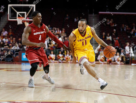 Southern California's Jordan McLaughlin dribbles past Washington State's Viont'e Daniels during the second half of an NCAA college basketball game, in Los Angeles