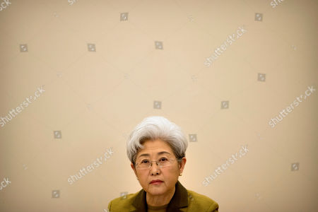Fu Ying, the spokeswoman for China's National People's Congress, listens to a reporter's question during a press conference held at the Great Hall of the People in Beijing, . Fu said on Saturday that China will raise its defense budget by about 7 percent this year, continuing a trend of lowered growth amid a slowing economy