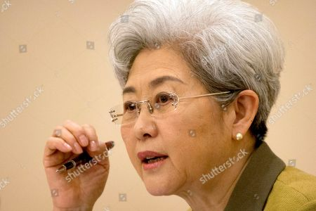 Fu Ying, the spokeswoman for China's National People's Congress, speaks during a press conference held at the Great Hall of the People in Beijing, . Fu said on Saturday that China will raise its defense budget by about 7 percent this year, continuing a trend of lowered growth amid a slowing economy