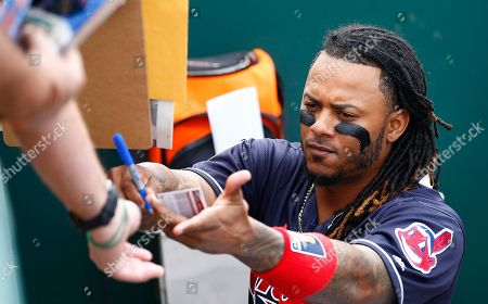 Cleveland Indians second baseman Michael Martinez signs autographs for fans prior to a spring training baseball game against the Colorado Rockies, in Goodyear, Ariz. The Rockies defeated the Indians 16-7