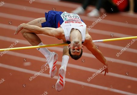 Britain's Robbie Grabarz makes an attempt in the men's high jump qualification during the European Athletics Indoor Championships in Belgrade, Serbia