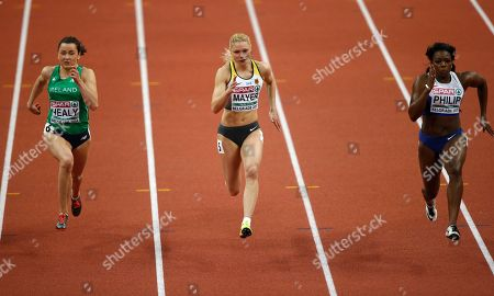 Ireland's Phil Healy, Germany's Lisa Mayer and Britain's Asha Philip, from left, compete in a women's 60-meter first round heat during the European Athletics Indoor Championships in Belgrade, Serbia