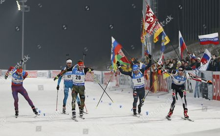 Dominik Landertinger (R) of Austria, Benedikt Doll (3-L) of Germany, Lowell Bailey (L) of the United States, Lukas Hofer (2-R) of Italy and Jean Guillaume (2-L) of France cross the finish line during the men's 12.5km pursuit race of the IBU Biathlon World Cup in PyeongChang, South Korea, 04 March 2017.