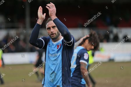 Stock Photo of Leyton Orient Captain Nick Hunt (16) celebrates the win with the traveling fans during the EFL Sky Bet League 2 match between Newport County and Leyton Orient at Rodney Parade, Newport