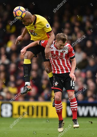 Younes Kaboul of Watford jumps onto James Ward-Prowse of Southampton during the Premier League match between Watford and Southampton played at Vicarage Road, Watford on 4th March 2017