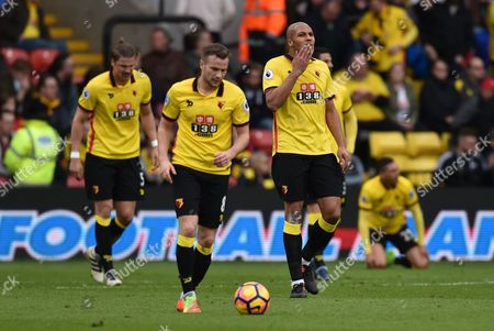 A dejected Tom Cleverly and Younes Kaboul of Watford during the Premier League match between Watford and Southampton played at Vicarage Road, Watford on 4th March 2017
