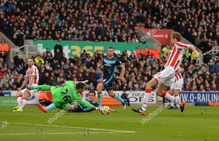 Peter Crouch of Stoke City sees his shot blocked by Victor Valdes of Middlesbrough during the Premier League match between Stoke City and Middlesbrough played at the bet365 Stadium, Stoke-on-Trent on 4th March 2017
