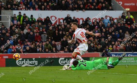 Marko Arnautovic of Stoke City beats Victor Valdes of Middlesbrough to score his side's first goal during the Premier League match between Stoke City and Middlesbrough played at the bet365 Stadium, Stoke-on-Trent on 4th March 2017