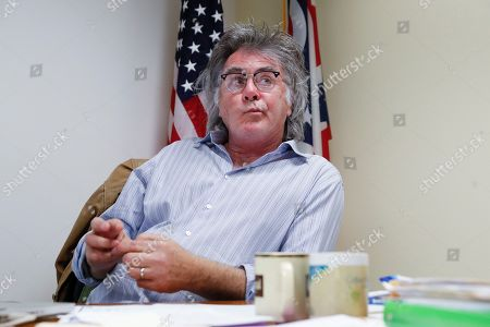 """Stock Photo of Hillsboro mayor Drew Hastings is interviewed at his offices in Hillsboro, Ohio. The small Ohio city is trying to recover from what a local newspaper calls Hillsboro's """"lost year."""" Its mayor, veteran standup comedian Drew Hastings, was the subject of a wide-ranging investigation that resulted in his indictment on four felony counts. He was acquitted in November, followed by the police chief's resignation and the firing of the city's safety and services director. Now local leaders are trying, as a city councilman says, to """"put the past in the past"""