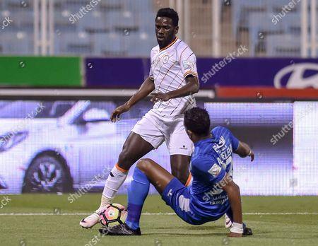 Al-Shabab player Abdulaziz Albishi (L) in action for the ball with Al-Fateh player Hassan Aldossri (R) during the Saudi Professional League soccer match between Al-Fateh and Al-Shabab at Prince Abdullah bin Jalawi Stadium, Al-Hasa, Saudi Arabia, 04 March 2017