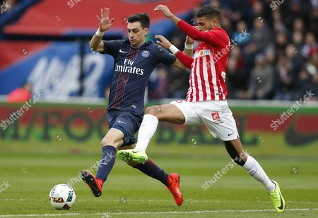 Paris Saint Germain midfielder Javier Pastore (L) fights for the ball with Nancy's Youssef Ait Bennasser (R) during the French league 1 soccer game between Paris Saint Germain and Nancy at the Parc des Princes Stadium in Paris, France, 04 March 2017.