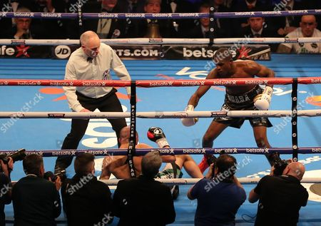 Ohara Davies knocks down Derry Mathews winning the fight   at The O2 Arena , Peninsula Square  , London  on 4th March  2017